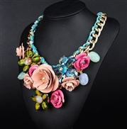 big European and American models wearing colored gemstone pendant flowers woven rope necklace